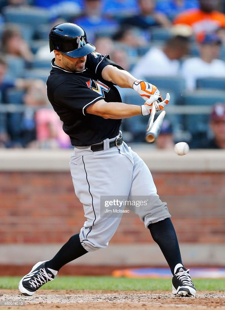 Reed Johnson #5 of the Miami Marlins breaks his bat as he grounds out in the ninth inning against the New York Mets at Citi Field on July 12, 2014 in the Flushing neighborhood of the Queens borough of New York City. The Mets defeated the Marlins 5-4.