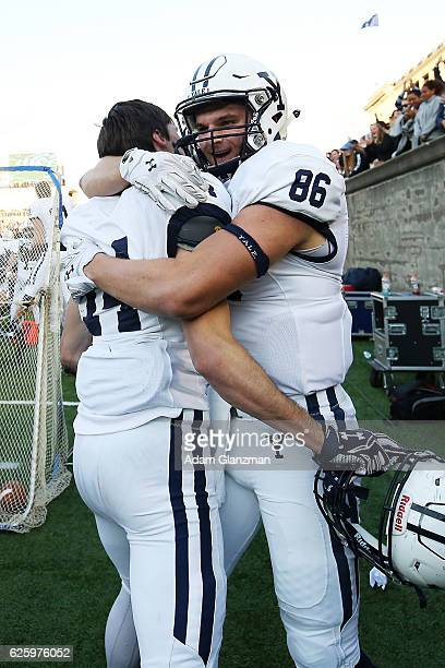 Reed Klubnik and John Lager of the Yale Bulldogs react after scoring a touchdown in the fourth quarter of a game against the Harvard Crimson at...