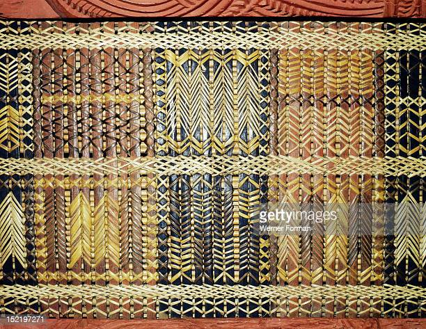 Reed latticework panels woven by women alternated with the carved wooden ancestor figures along the side wall of meeting houses This example was made...