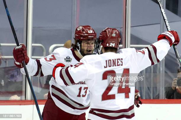 Reed Lebster of the Massachusetts Minutemen is congratulated by Zac Jones after scoring a goal against the St. Cloud St. Huskies during the first...