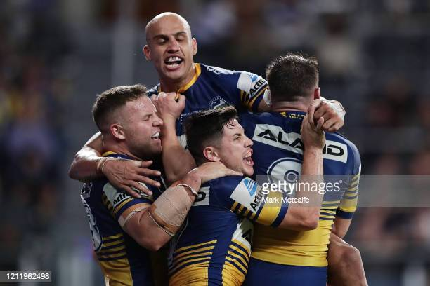 Reed Mahoney of the Eels celebrates scoring a try with team mates during the round 1 NRL match between the Parramatta Eels and the Canterbury...