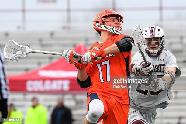 Reed Malas of the Bucknell Bison shoots the ball against the defense of Danny Healey of the Colgate Raiders during the first half at Andy Kerr...