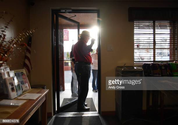 Reed Mitchell Owner of the Rimrock Hotel in Naturita Colorado stops in the doorway to talk to customers of the hotel October 19 2017 Reed employs 18...
