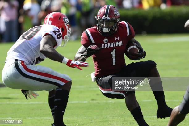 R Reed of Georgia closes in on Deebo Samuel wide receiver The University of South Carolina as he looks to try and make a cut back during action...