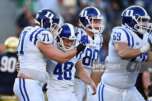 Reed of the Duke Blue Devils is congratulated by teammates after kicking the game winning field goal against the Notre Dame Fighting Irish at Notre...