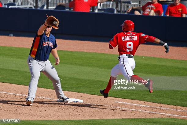 J Reed of the Houston Astros gets Rafael Bautista of the Washington Nationals out in the sixth inning during a spring training game at The Ballpark...