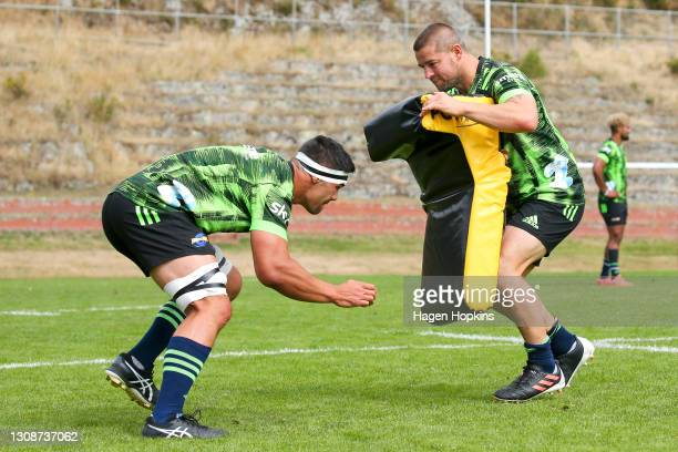 Reed Prinsep and Dane Coles take part in a drill during a Hurricanes Super Rugby training session at Rugby League Park on March 24, 2021 in...