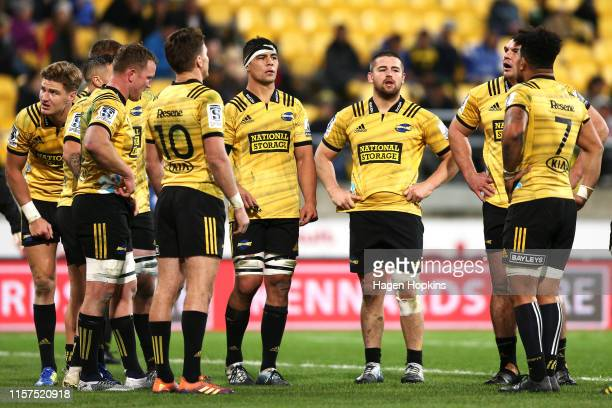 Reed Prinsep Dane Coles and Ben May of the Hurricanes look on during the Super Rugby Quarter Final match between the Hurricanes and the Bulls at...