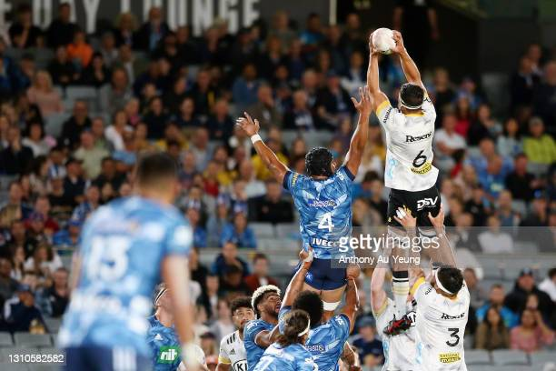 Reed Prinsep of the Hurricanes and Gerard Cowley-Tuioti of the Blues compete at the lineout during the round 6 Super Rugby Aotearoa match between the...
