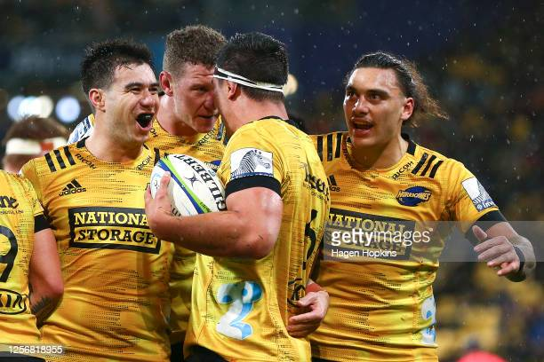 Reed Prinsep of the Hurricanes celebrates with Jackson Garden-Bachop, Scott Scrafton and Peter Umaga-Jensen after scoring a try during the round 6...