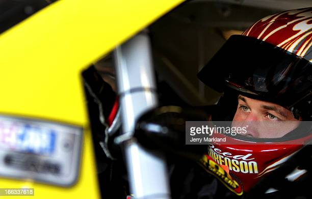Reed Sorenson driver of the Pilot Ford sits in his car during practice for the NASCAR Nationwide Series O'Reilly Auto Parts 300 at Texas Motor...