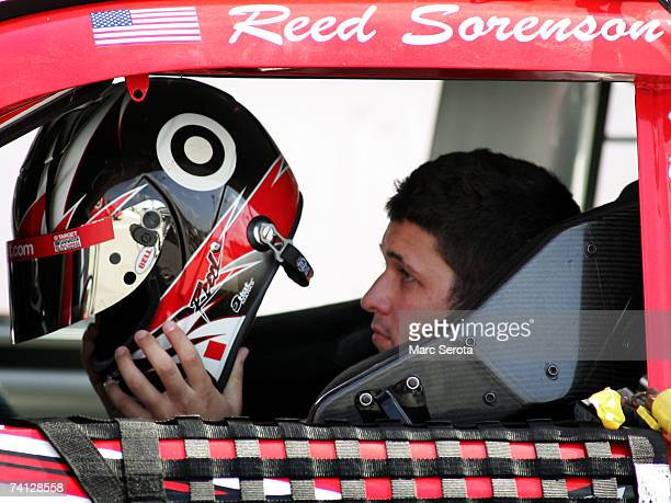 Reed Sorenson, driver of the Target Dodge, prepares to put on his helmet while sitting in his car, during qualifying for the NASCAR Nextel Cup Series...