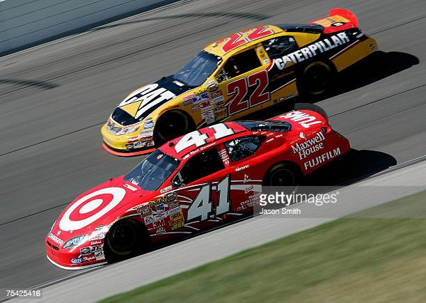 Reed Sorenson driver of the Target/Maxwell House Dodge leads Dave Blaney driver of the Caterpillar Toyota during the NASCAR Nextel Cup Series USG...