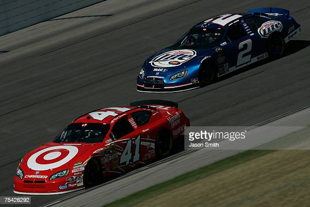 Reed Sorenson driver of the Target/Maxwell House Dodge leads Kurt Busch driver of the Miller Lite Dodge during the NASCAR Nextel Cup Series USG...