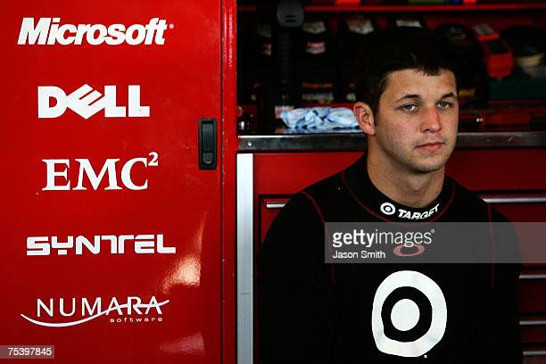 Reed Sorenson driver of the Target/Maxwell House Dodge looks on in the garage during practice for the NASCAR Nextel Cup Series USG Sheetrock 400 at...