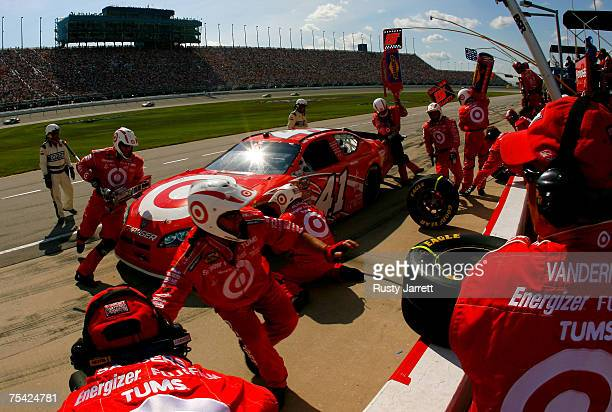 Reed Sorenson driver of the Target/Maxwell House Dodge makes a pit stop during the NASCAR Nextel Cup Series USG Sheetrock 400 at Chicagoland Speedway...