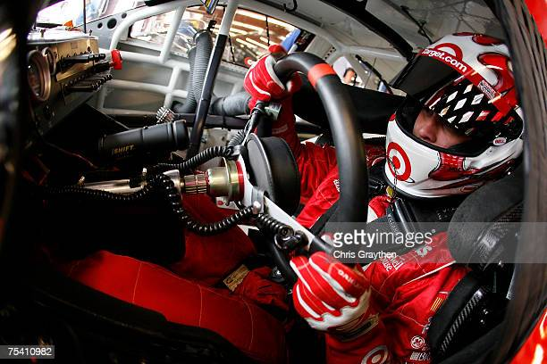 Reed Sorenson driver of the Target/Maxwell House Dodge sits in his car in the garage during practice for the NASCAR Nextel Cup Series USG Sheetrock...