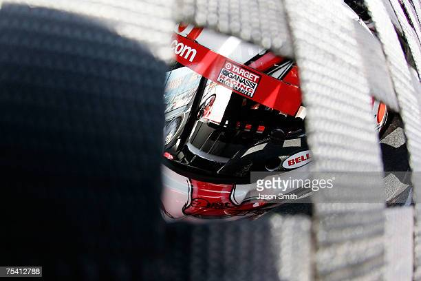 Reed Sorenson driver of the Target/Maxwell House Dodge sits in his car during practice for the NASCAR Nextel Cup Series USG Sheetrock 400 at...
