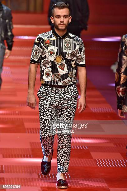 Reed Tankersley walks the runway at the Dolce Gabbana show during Milan Men's Fashion Week Spring/Summer 2018 on June 17 2017 in Milan Italy