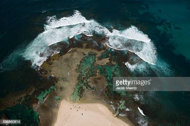 Reef coastline with beach from above