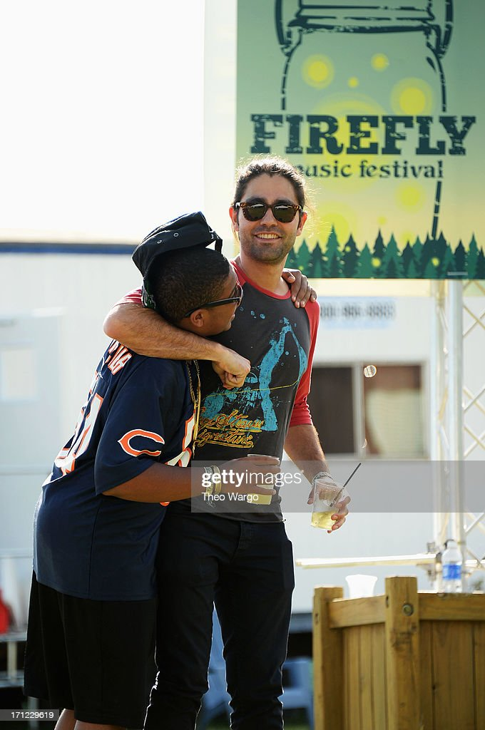 Reef Mckeithan (L) and Adrian Grenier hang out at the Artist Compound at the Firefly Music Festival at The Woodlands of Dover International Speedway on June 22, 2013 in Dover, Delaware.