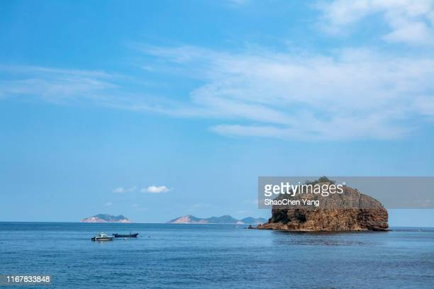 reef with boats - liaoning province stock pictures, royalty-free photos & images