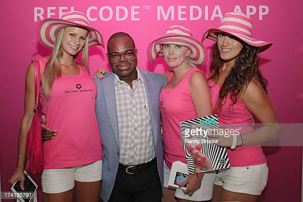 Reel Code Founder Isaac Daniel pose with his hostess' at Mercedes-Benz Fashion Week Swim 2014 at Raleigh Hotel on July 20, 2013 in Miami Beach,...