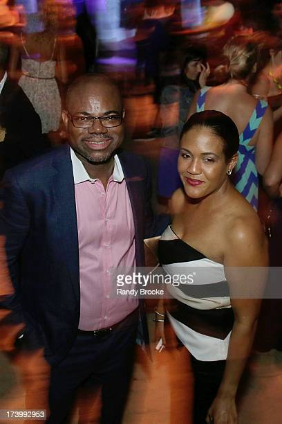 Reel Code Founder Isaac Daniel with CEO Alexia Jones At MercedesBenz Fashion Week Swim 2014 Kick Off Party at Raleigh Hotel on July 18 2013 in Miami...