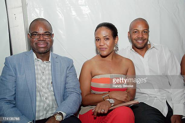 Reel Code Founder Isaac Daniel with his CEO Alexia Jones and guest at the CM Cia Maritima show at MercedesBenz Fashion Week Swim 2014 at Raleigh...