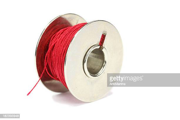 reel of red thread isolated on white