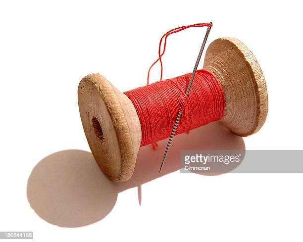 reel of thread - sewing needle stock pictures, royalty-free photos & images