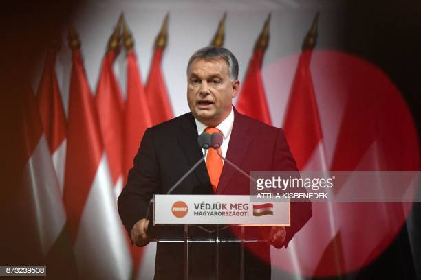 Reelected chairman of the governing FIDESZ party Hungarian Prime Minister Viktor Orban talks on the podium during the party congress at the Hungexpo...