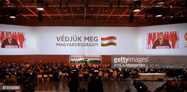 Reelected chairman of the governing FIDESZ party Hungarian Prime Minister Viktor Orban speaks on the podium during the party congress at the Hungexpo...