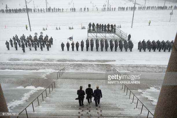 TOPSHOT Reelected Finnish President Sauli Niinistö heads to inspect the honorary guard outside the Finnish Parliament as part of the presidential...