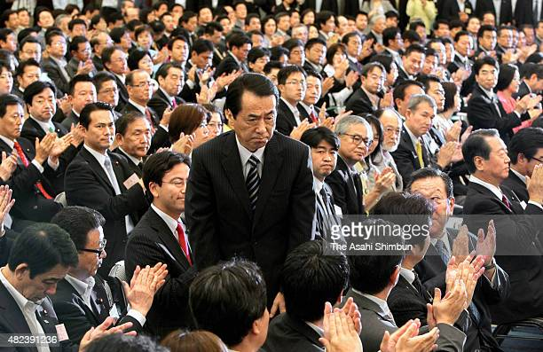 Reelected President Naoto Kan bows to appreciate to his colleagues during the Democratic Party of Japan presidential election on September 14 2010 in...