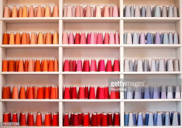 Reels of cashmere wool sit displayed inside Brunello Cucinelli's office in Solomeo near Perugia Italy on Thursday Aug 30 2012 Brunello Cucinelli SpA...