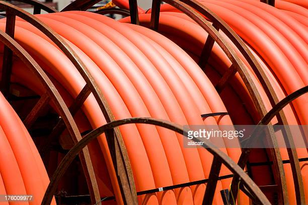 Reels of orange communication cable.