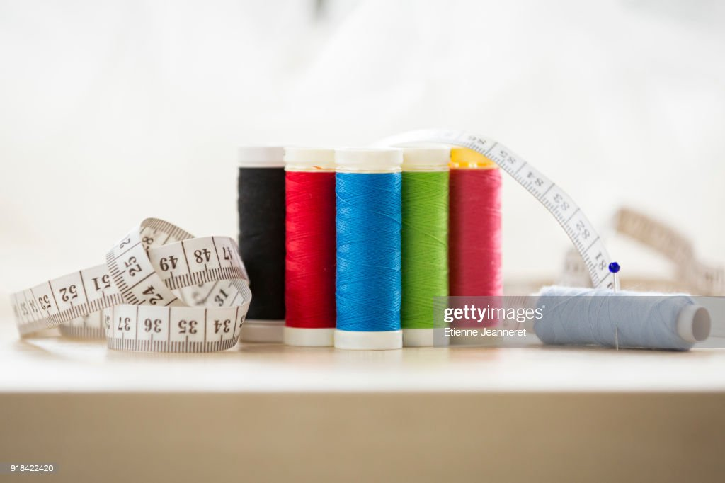 6 reels of threads with measuring tape, Nancy, France : Stock Photo