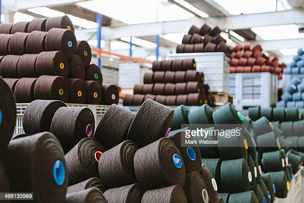 reels of wool in storage room in woollen mill - textile industry stock pictures, royalty-free photos & images