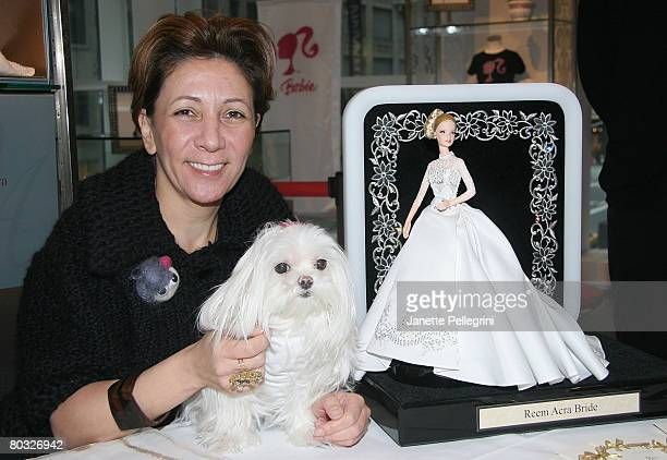 Reem Acra and her dog Lulu sign her Platinum Label Bride Barbie dolls at F.A.O Schwartz October 26, 2007 in New York City.