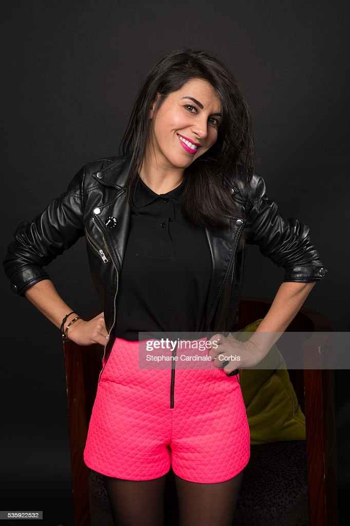 Reem Kherici poses at a photo session during the 'American Bluff' Party at Pavillon Champs Elysees, in Paris.