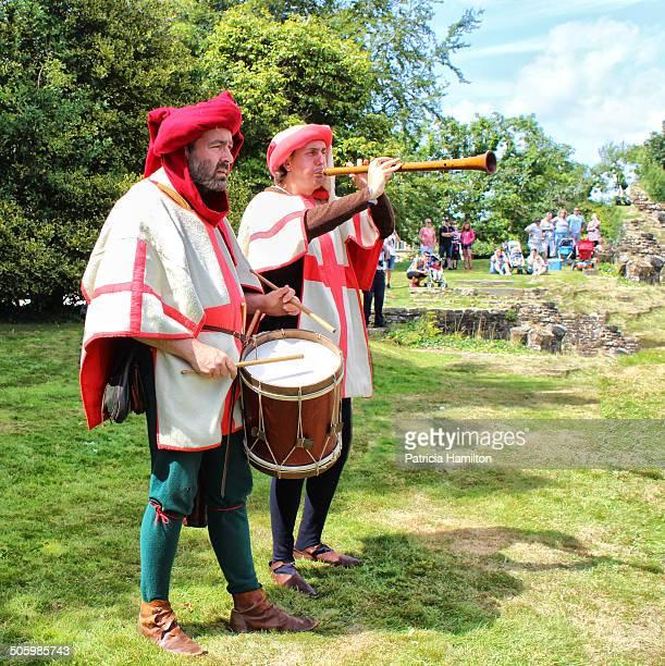 Reenactment of mediaeval musicians entertaining battle troops