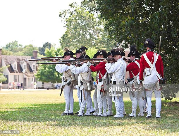 reenactment of redcoats seizing williamsburg - colonial williamsburg stock photos and pictures