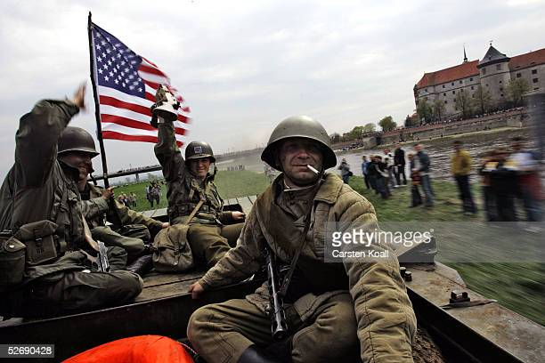 A reenactment of the historical meeting of US and Soviet troops on the Elbe River is played out April 24 2005 in Torgau Germany Tomorrow is the 60th...
