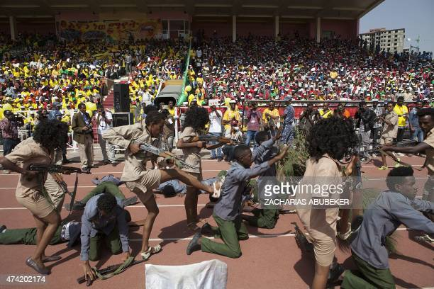 A reenactment of the war between the Tigray guerrilla fighters and the Ethiopian communist regime is played out on May 21 2015 in Addis Ababa during...