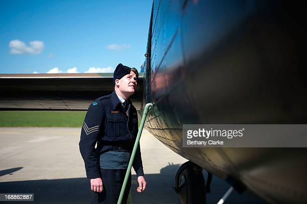 WWII reenactor admires a WWII Lancaster bomber at RAF Scampton on May 16 2013 in Lincoln England Ladybower and Derwent reservoirs were used by the...
