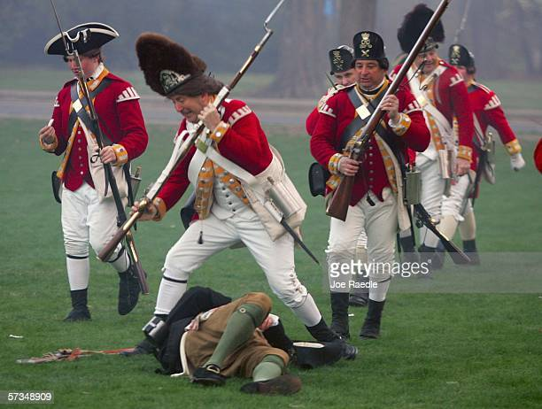 Re-enactor dressed as a British soldier walks over a fallen Lexington militia member after the Battle of Lexington April 17, 2006 in Lexington,...