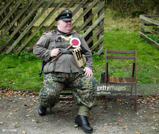 A reenactor dressed as a German Army soldier rests during the North Yorkshire Moors Railway 1940's Wartime Weekend event on October 14 2017 in...