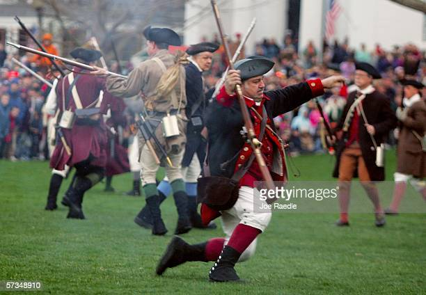 Re-enactor dressed as a Lexington militia member falls to the ground after being shot by British soldiers during the Battle of Lexington April 17,...