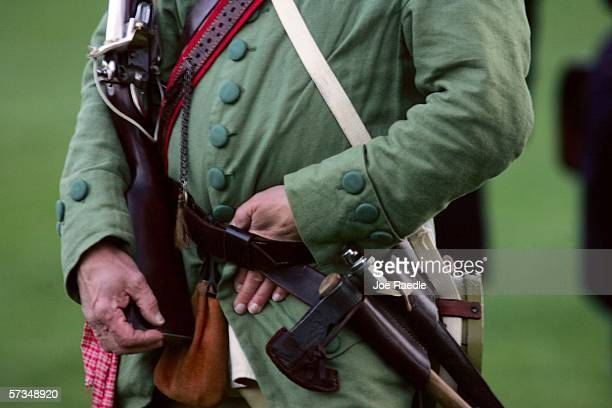 Re-enactor dressed as a Lexington militia member wears his uniform while waiting to fight the British soldiers during the Battle of Lexington April...